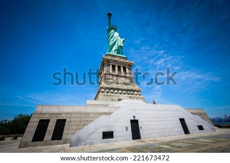 NEW YORK CITY - JUNE 18, 2014: Tourists in front of The Statue of Liberty. The statue, designed by F. A. Bartholdi and dedicated on October 28, 1886, was a gift to the USA from the people of France. - stock photo