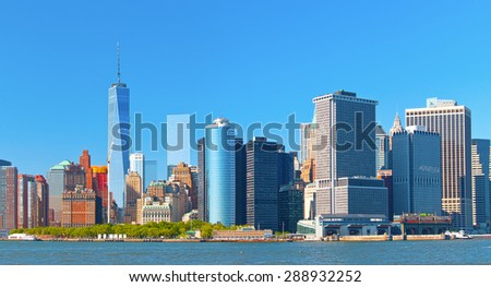New York City lower Manhattan financial  wall street district buildings skyline on a beautiful summer day with blue sky - stock photo
