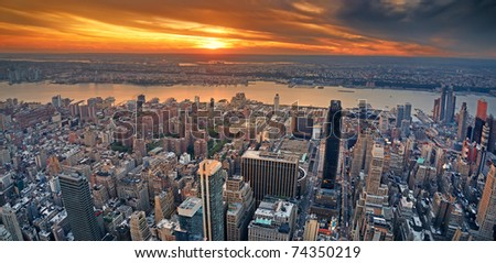 New York City Manhattan aerial panorama view with New Jersey from west Hudson River and skyscrapers at sunset. - stock photo