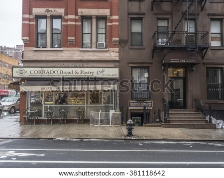 New York City,Manhattan  Bakery and apartment building on upper east side during winter rain 2/16/2016, 12:12:18 PM - stock photo