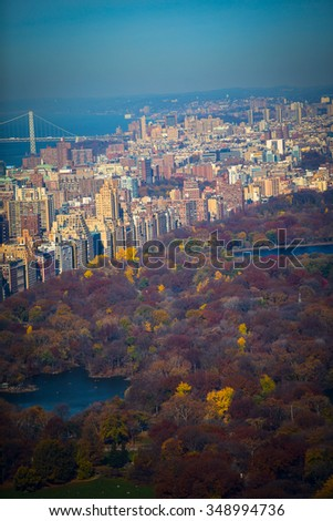 New York City Manhattan Central Park panorama in Autumn lake with skyscrapers and colorful trees with reflection. - stock photo