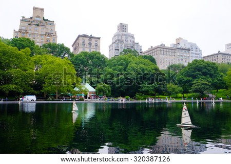 New York City Manhattan Central Park panorama with lake, boats and skyscrapers. - stock photo