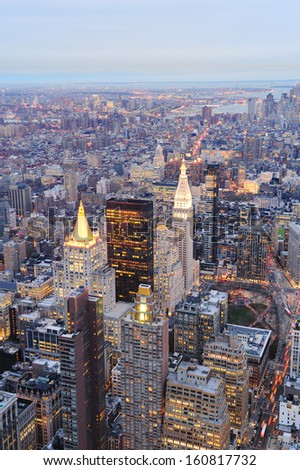 New York City Manhattan downtown aerial view at dusk with urban city skyline and skyscrapers buildings - stock photo