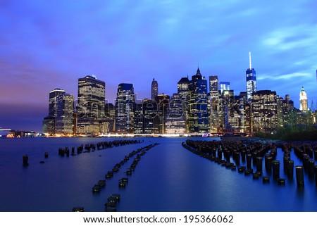 New York City Manhattan Downtown Skyline at Dusk overlooked from Brooklyn Bridge Park - stock photo