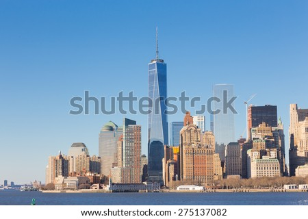 New York City Manhattan downtown skyline at sunset with skyscrapers illuminated over Hudson River panorama. Horisontal composition - stock photo