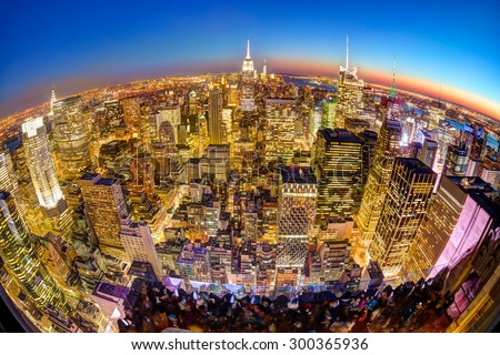 New York City. Manhattan downtown skyline with illuminated Empire State Building and skyscrapers at dusk seen from observation deck. Panoramic fish eye view. - stock photo
