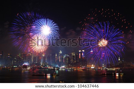 New York City Manhattan July 4th Independence day fireworks show with skyline over Hudson River viewed from New Jersey - stock photo