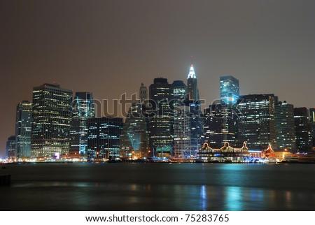 New York City Manhattan night scene panorama with city skyline over Hudson River. - stock photo