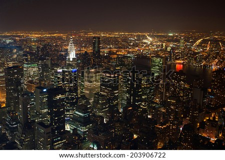 New York City Manhattan  panorama aerial view at night with office building skyscrapers skyline - stock photo