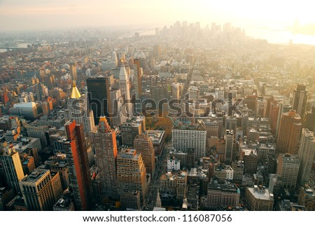 New York City Manhattan panorama aerial view with skyline at sunset.