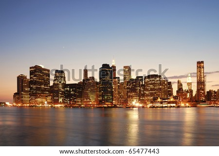 New York City Manhattan skyline at dusk over Hudson River with skyscrapers - stock photo