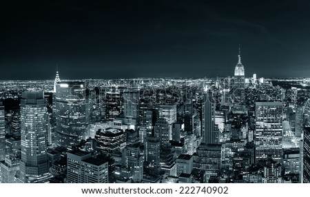New York City Manhattan skyline at night panorama black and white with urban skyscrapers. - stock photo