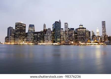 New York City Manhattan skyline at sunset over Hudson River, skyscrapers - stock photo