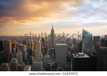 New York City Manhattan skyline at sunset with empire state building - stock photo