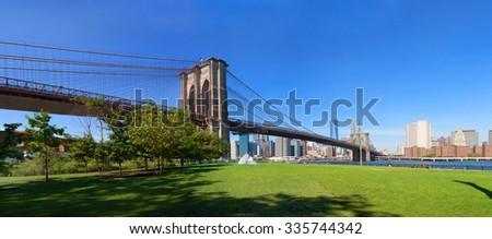 New York City Manhattan skyline panorama with Brooklyn Bridge  - stock photo