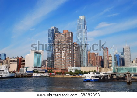 New York City Manhattan skyline with skyscrapers over Hudson river.
