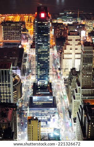 New York City Manhattan street aerial view at night with skyscrapers, pedestrian and busy traffic. - stock photo