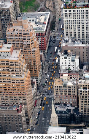 New York City Manhattan street aerial view with skyscrapers, pedestrian and busy traffic. - stock photo