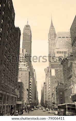 New York City Manhattan street view with Chrysler Building skyscrapers and busy traffic black and white. - stock photo