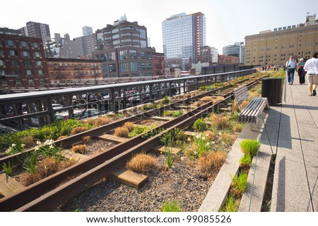 NEW YORK CITY - MAR. 23:  High Line Park in NYC seen on March 23, 2012.The High Line is a public park built on an historic freight rail line elevated above the streets on Manhattans West Side. - stock photo