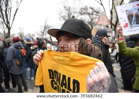 NEW YORK CITY - MARCH 19 2016: A thousand activists gathered at Columbus Circle to oppose Republican front-runner Donald Trump, marching to Trump Tower during which NYPD officers made several arrests.