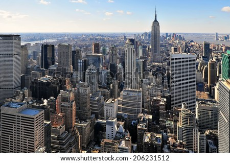 New York City - March 09: Amazing Manhattan skyline aerial view with Empire State Building. Manhattan is one of the most densely populated areas in the world, March 09, 2008 New York - stock photo