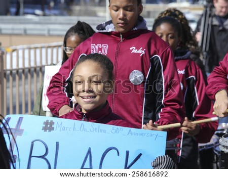 NEW YORK CITY - MARCH 7 2015: Brooklyn borough president Eric Adams led several hundred marchers across the Brooklyn Bridge to borough hall in commemoration of the 50th anniversary of Bloody Sunday - stock photo