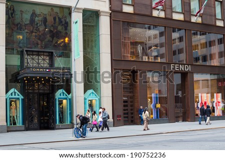 NEW YORK CITY - MARCH 14, 2014: Designer stores on fashionable Fifth Avenue in Manhattan.  This prestigious street is lined with some of the most expensive stores in the world.  - stock photo
