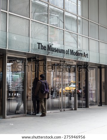 NEW YORK CITY - MARCH 14, 2014: Entrance to The Museum of Modern Art with people entering in Manhattan. This landmark museum opened its doors to the public in 1929. - stock photo