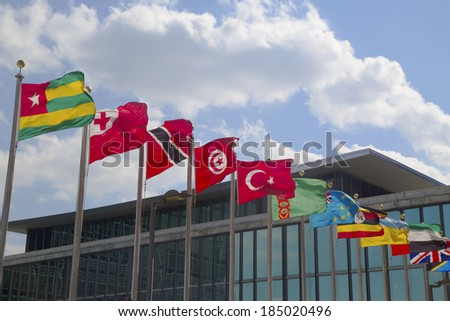 NEW YORK CITY - MARCH 20: International Flags in the front of United Nations Headquarter in New York on March 20, 2014  - stock photo
