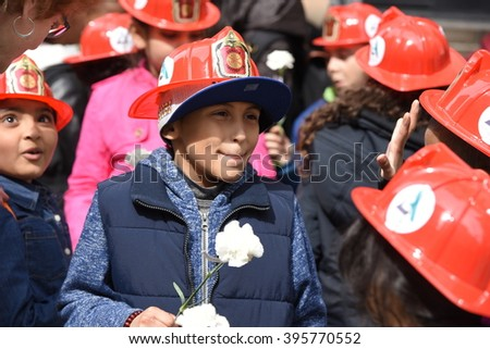 NEW YORK CITY - MARCH 23 2016:  Labor, political & religious leaders  gathered to commemorate the anniversary of the Triangle Shirtwaist fire, that killed 146 workers. Schoolkids with white roses