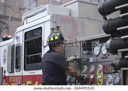 NEW YORK CITY - MARCH 27 2015: one day after a fire & explosion in Manhattan's East Village, two people remain missing while emergency personnel clear the wreckage of three destroyed brownstones - stock photo
