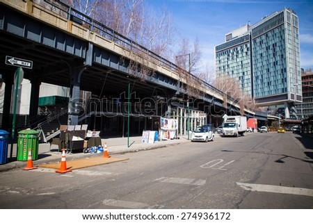 NEW YORK CITY - MARCH 13, 2015:  Street view of High Line Park and The Standard Hotel in Manhattan - stock photo