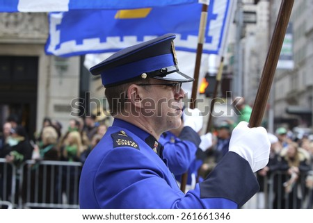 NEW YORK CITY - MARCH 17 2015: the 254th St. Patrick's Day parade, led by grand marshal Timothy Cardinal Dolan, filled Fifth Avenue in Midtown in spite of protests from the Irish Queers organization