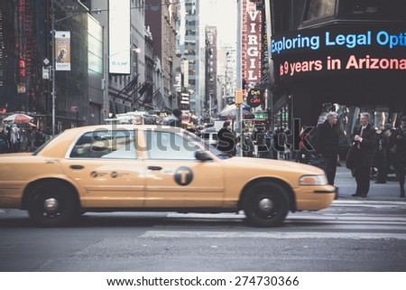 NEW YORK CITY - MARCH 23 2015:  Vintage style street scene along world famous Times Square at Broadway in midtown Manhattan.  - stock photo