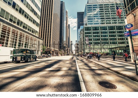 NEW YORK CITY - MAY 21: Beautiful view of Fifth Avenue on May 21, 2013 in New York City. Fifth Avenue has the world's most expensive retail spaces as the symbol of wealthy New York - stock photo