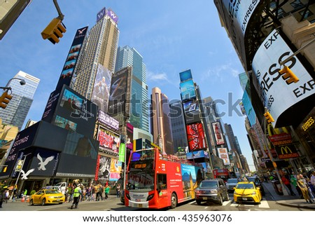NEW YORK CITY - MAY 09: Cars, bus and taxi cabs at 7th Avenue and Broadway in Times Square with crowds of people and lots of advertising on May 09, 2016 in New York, NY, USA.  - stock photo