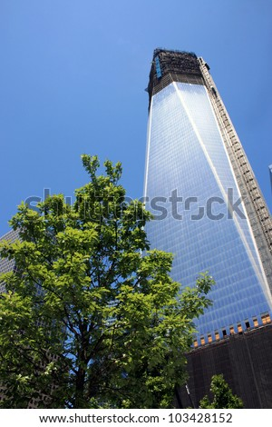 NEW YORK CITY - MAY 19: Construction on One World Trade Center (formerly the Freedom Tower) surpasses the 100th floor on May 19, 2012 in New York City, NY. - stock photo