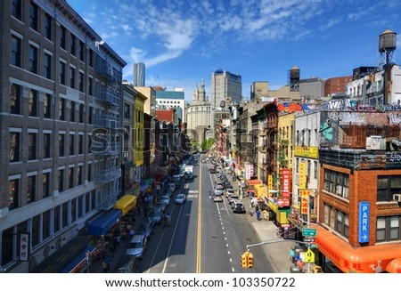 NEW YORK CITY - MAY 13: East Broadway in Chinatown May 13, 2012 in New York, NY. It is the largest and oldest  such enclave in the Western Hemisphere with nearly 100,000 residents. - stock photo