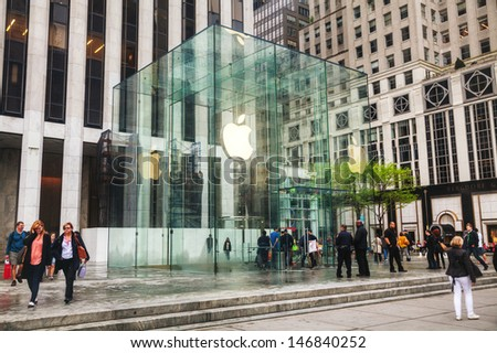 NEW YORK CITY - MAY 12: Entrance to Apple retail store on May 12, 2013 in New York. The Apple Store is a chain of retail stores owned and operated by Apple Inc. - stock photo