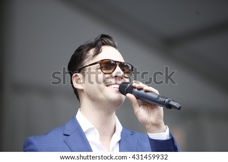 NEW YORK CITY - MAY 30 2016: Green-Wood Cemetery staged it's 28th annual Memorial Day concert by the Symphonic Orchestra at 3rd Street. Broadway singer Ryan Silverman sings Leonard Bernstein