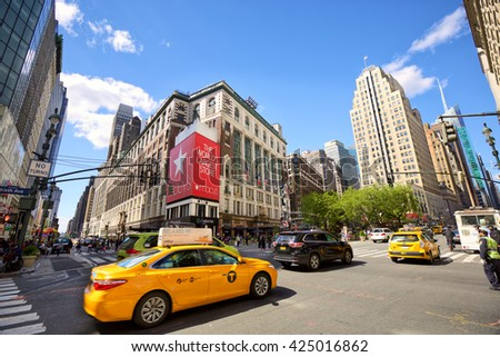 NEW YORK CITY - MAY 08: Herald Square with busy traffic, yellow taxi and crowds of people on May 08, 2016 in Midtown Manhattan, New York, NY, USA. - stock photo