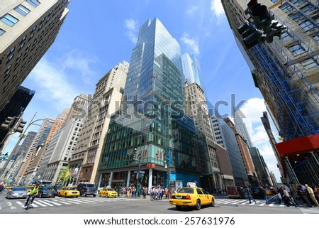 NEW YORK CITY - MAY 7: Manhattan Intersection and Skyscrapers wide angle at Fifth Avenue and Chrysler Building on 42th Street, Midtown Manhattan on May 7th, 2013 in New York City, USA - stock photo