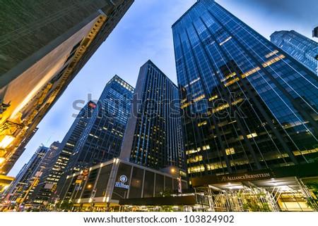 NEW YORK CITY - MAY 15: Manhattan street view of Sixth Avenue at night/dusk on May 15, 2012. - stock photo