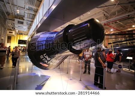 NEW YORK CITY - 25 MAY 2015: Mayor Bill de Blasio & Gen John Kelly presided over Memorial Day observances on Pier 86 by the USS Intrepid. Mercury space capsule inside hanger deck, USS Intrepid - stock photo