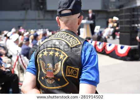 NEW YORK CITY - 25 MAY 2015: Mayor Bill de Blasio & Gen John Kelly presided over Memorial Day observances on Pier 86 by the USS Intrepid. Veteran MC member watches ceremony - stock photo