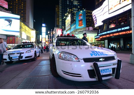 NEW YORK CITY - MAY 6: NYPD police car in Times Square at night, Manhattan on May 6th, 2013 in New York City, USA - stock photo