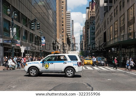 NEW YORK CITY - MAY 11, 2015: NYPD Police car on 42nd street. The New York City Police Department, established in 1845, is the largest municipal police force in the United States. Stock video  - stock photo