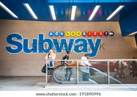 NEW YORK CITY - MAY 26: Pedestrians at the entrance of the 42nd St. and 9th Ave. subway station entrance on May 26, 2011.  42nd St. and 9th Ave. is also home to Port Authority. - stock photo
