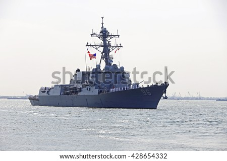 NEW YORK CITY - MAY 25 2016: Ships of the US Navy docked in the Brooklyn Ferry Terminal as the 28th annual Fleet Week started. USS Bainbridge, DDG-96, arrives in NY Harbor